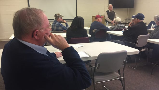 Darrell Banks, a Richland County Commissioner, looks on Thursday during a discussion of proposed dams along the Black Fork River.
