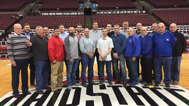 Members of the 1998 Highland High School boys basketball team celebrated their 20-year anniversary of winning the Division III state championship. They were honored on Friday at the boys state basketball tournament.