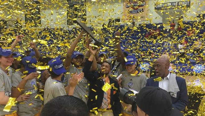 The TCC women's basketball team celebrates its national title Saturday night in Lubbock, Texas.