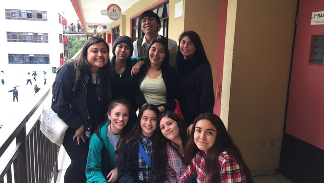 Yesenia Ayala, left, poses for a photo with some of her students in Santiago, Chile.
