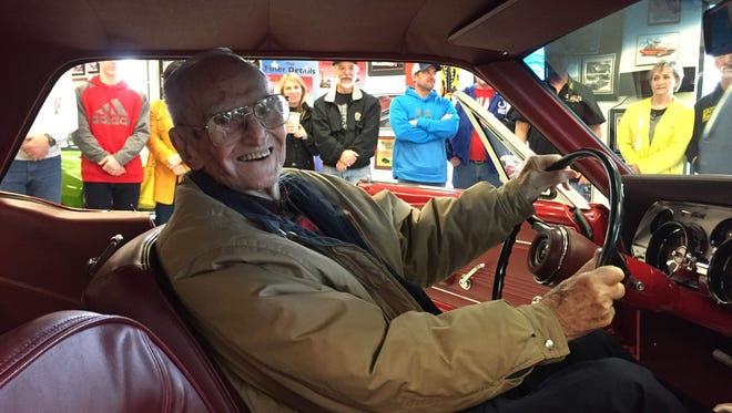 Harry Donovan smiles from behind the wheel of his restored 1967 Mustang at The Finer Details shop in Danville. Volunteers raised money and restored the car at no cost to Donovan after the WWII veteran was ripped off by a man he'd paid nearly $8,000 to do the work.