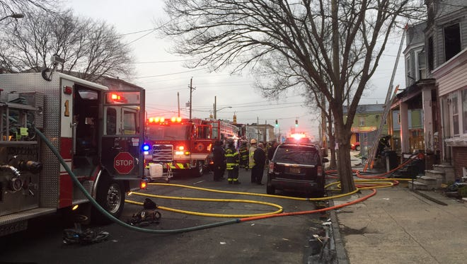 Fire crews battle a fire at a vacant home Tuesday morning in Wilmington.