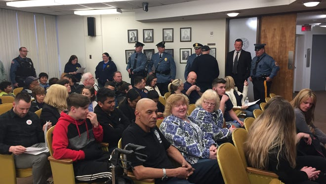 Regular business had to wait at Tuesday night's Millville City Commission meeting for a celebration of Police Athletic League achievements. Athletes, their families, and league leaders and volunteers packed the meeting room.
