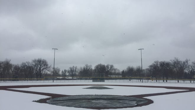 The City Park baseball field covered in snow Friday. Saturday's Fort Collins-Rocky Mountain baseball game has been moved to 3 p.m. at Rocky Mountain.