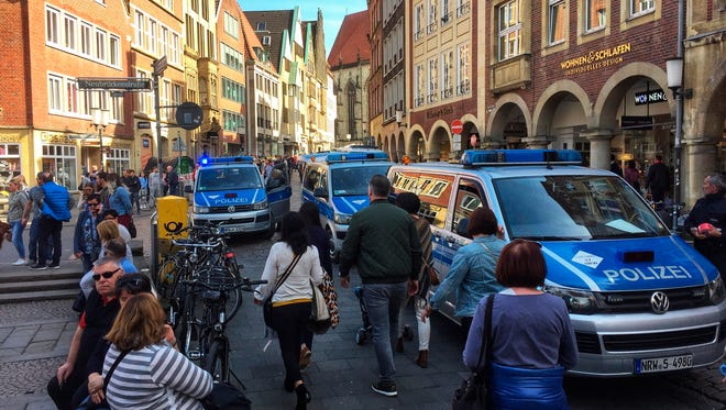 Police vans stand in downtown Muenster, Germany, on April 7, 2018.