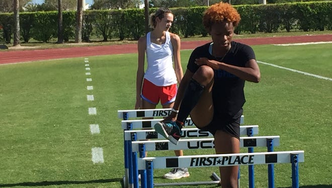 CSN freshman Loren Brown executes a hurdling drill during Tuesday afternoon's practice. Brown has shattered the school record in both the 100 and 300 hurdles, and is looking forward to what she hopes is a big postseason.