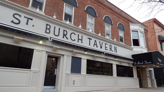 The front of St. Burch Tavern, facing Iowa Avenue, in Iowa City is shown on April 11, 2018.