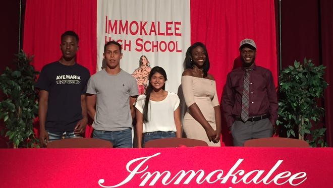 Five Immokalee student-athletes signed on the dotted line Wednesday to continue their athletic and academic careers in college. From left are: Soccer player Cedric Georges (Ave Maria), soccer player Carlos Contreras (Florida College), softball player Stephanie Vargas (Tennessee State), volleyball player Estfania Louis (North Carolina Central) and cross country/track athlete Mackenson Yrelus (North Carolina Central).