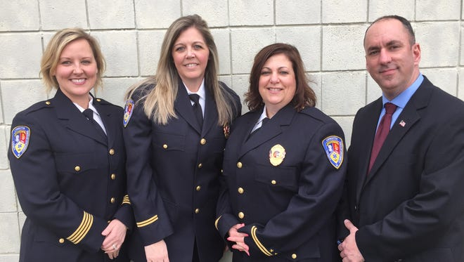 Joni Harvey, director of Livingston County Central Dispatch, with Jill Breen, Lori Bourbeau, and Dan Stevens, who all received special recognition at a dispatch awards ceremony April 13, 2018. Breen received the director's award, Bourbeau was honored for 15 years of service, and Stevens was named employee of the year.