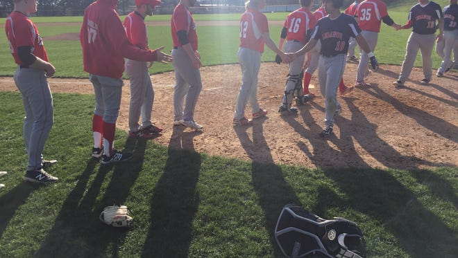 The Annville-Cleona and Lebanon baseball teams shake hands following A-C's 2-0 win at Coleman Park on Wednesday.