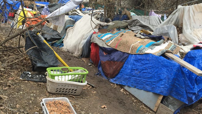 People have built extensive living quarters out of tarps, tents and other materials.