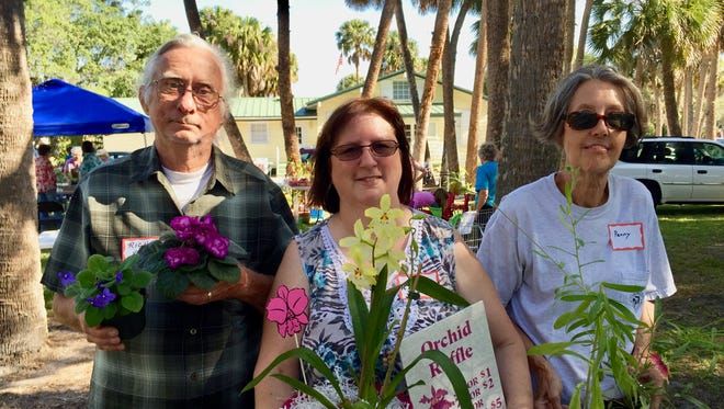 Richard Gray, left, of Treasure Coast Violet Society, Rita Zeblin of Fort Pierce Orchid Society, and Penny Snyder of Savannas State Park enjoy nature at the 2017 Plants in the Park.