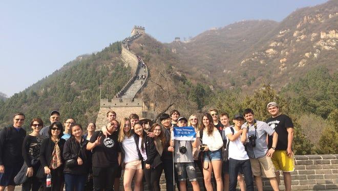 Sheboygan North and South students pose at the Great Wall of China during a 2018 spring break trip.