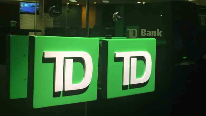 A former TD Bank teller is accused of helping to steal cash from customers' accounts.