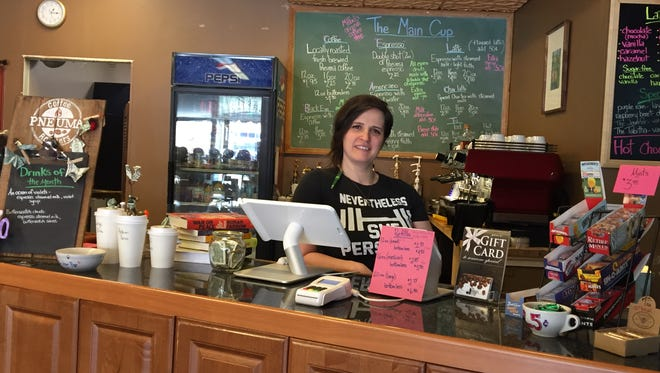 Jill Simmons  is the owner of The Main Cup in Milford, a combination coffee shop and bookstore.