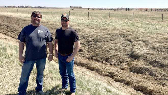 Steve Lettengarver and Cory Copenhaver show the land (behind the ditch) in Fairfield that will be home to Farm in the Dell Rocky Mountain Front. It's west of US Highway 89.