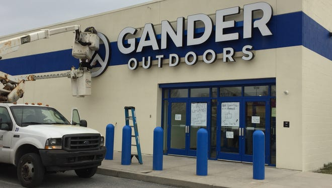 Workers put up the logo for Gander Outdoors on April 11, 2018. The store is opening at 725 Town Center Drive in West Manchester Township. The building, which once housed Gander Mountain, is expected to open in May 2018.