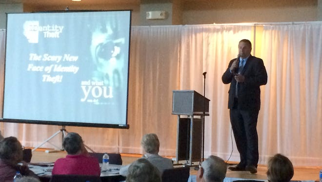 Tim Henry, VP of United Bankers Bank, warns an Indianola audience about identity thieves during a seminar presented by Peoples Bank.