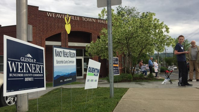 Campaign signs await voters at Weaverville Town Hall on Tuesday, May 8.