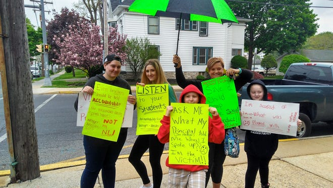 Northern Lebanon School District parents and students protest against the behavior of certain school administrators Thursday morning at the Lebanon County Courthouse.