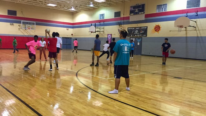 Teens play basketball and volleyball inside the gym of the Boys & Girls Club of Tolleson. After three decades in the city, the branch will close in May 2018.