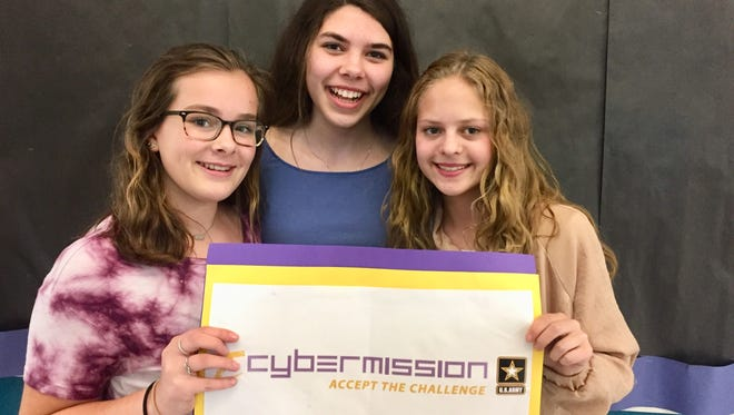 Lake Country School students (from left) Allie Knott, Isabella Boyd and Sophia Roehl won first place in the U.S. Army eCybermission competition for an app they created that touted the benefits of vaccines.