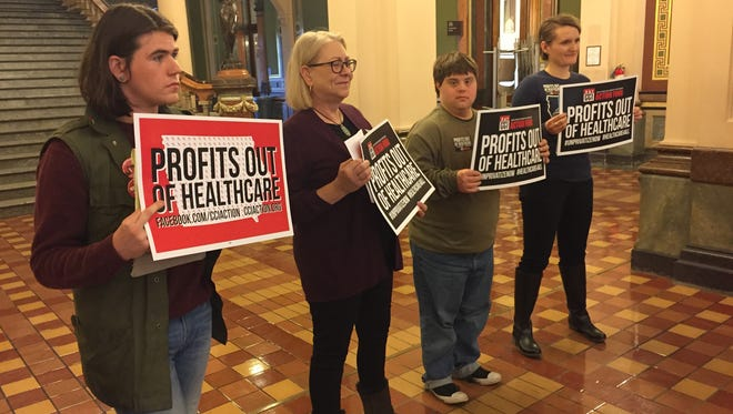 Opponents of privatized Medicaid appeared at the Iowa Statehouse Jan. 23, 2018.