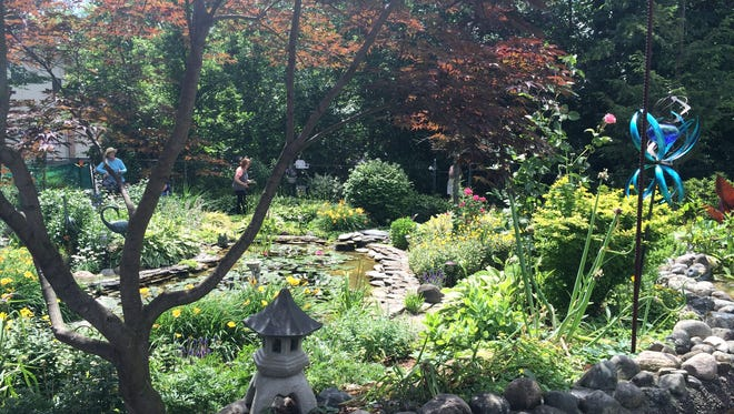 """Plymouth's Trailwood Garden Club will host its """"Flowers are Forever"""" garden walk on June 26."""