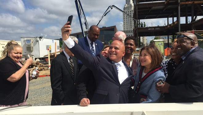 Camden Mayor Frank Moran (center) snaps a selfie at the topping-off ceremony for a Joint Health Sciences Center in 2018. Moran on Friday confirmed his plans to resign after 31 years as a city employee, councilman and mayor.