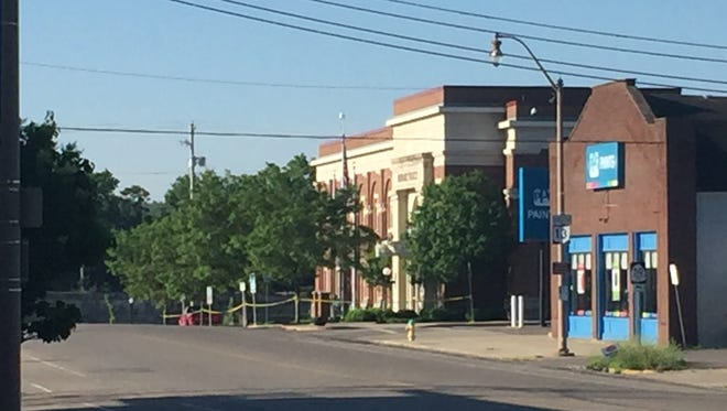 The Newark Police Department was evacuated Thursday after a suspicious package was found outside the building.