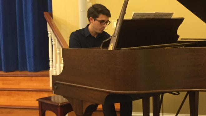Harrison Ponce is the first artist-in-residence at Kendal. Ponce, a recent Denison graduate, held the first of several planned concerts May 29 at Kendal.
