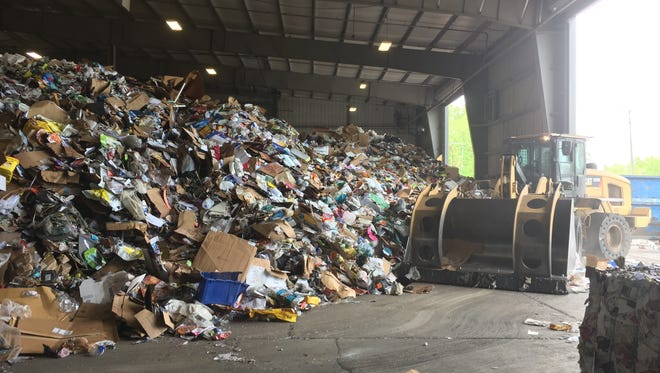 The tipping floor is the first stop for recyclables at the recycling authority in Southfield, brought by waste haulers from all over southeast Michigan, including Livingston County.