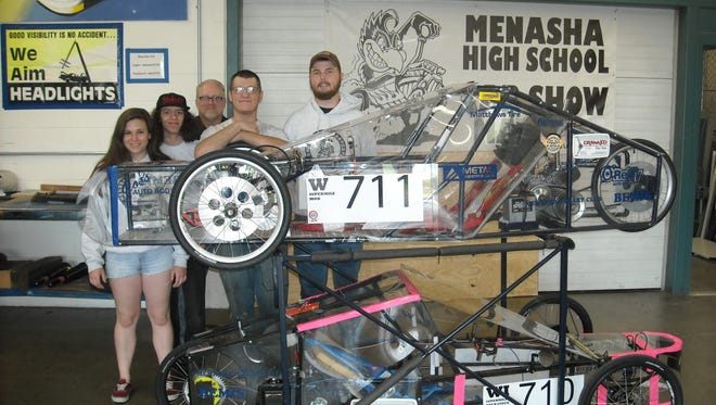 The Menasha High School Supermileage team finished its 2018 season at Road America on May 14-15. The older of the vehicles (711) came home with a first place in its class with an average of 332 miles per gallon and a best of 344 mpg. The newer vehicle (710) came home with a best of 252 miles per gallon. Pictured are Hannah Rataj, Malcolm Anderson, teacher Jay Olenski, Paul Kuhr and Talon Otradovec. Team member Aidan Smith, not pictured, also participated.