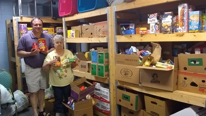 Volunteers ages 8-80 help pack and share Brown Bag Lunches every Tuesday and Thursday beginning June 12.