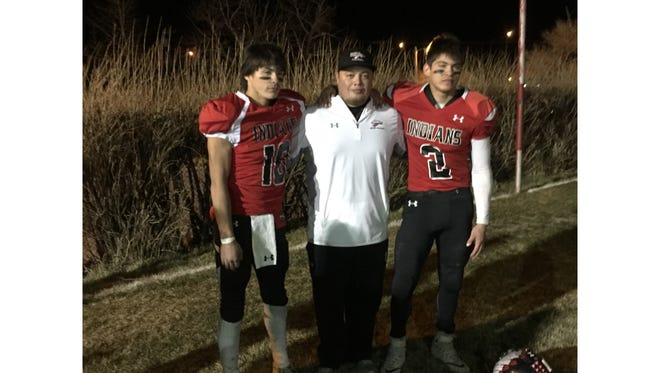 Browning head football coach Jerry Racine is flanked by twin brothers Derek, left, and Dylan Loring. The brothers plan to join the U.S. Marine Corps.