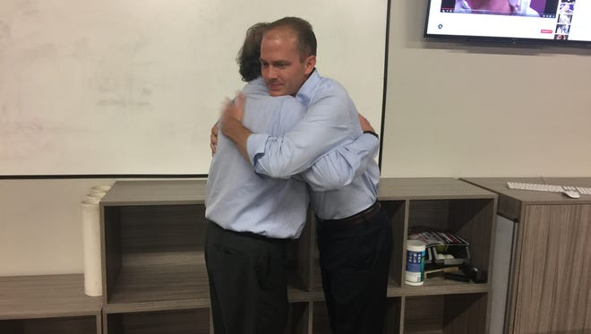 Sen. William Timmons hugs his father after Tuesday's Republican primary for South Carolina's 4th Congressional District seat.