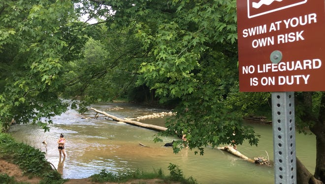 Groups of people gather at Big West Fork Creek in Clarksville.
