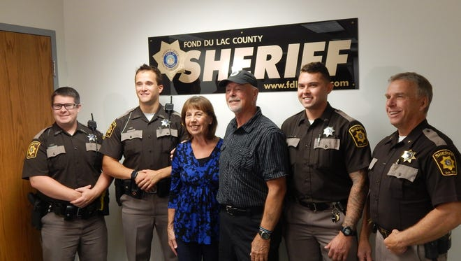 Ron Bohlman and his wife, Mary, met with the Fond du Lac County Sheriff's Office deputies who saved his life when he went into full cardiac arrest June 5. Pictured are, from left: Deputy Greg Anderson, Deputy Logan Will, Mary, Bohlman, Ron Bohlman, Correctional Deputy Cody Sokolik and Sheriff Mylan Fink.