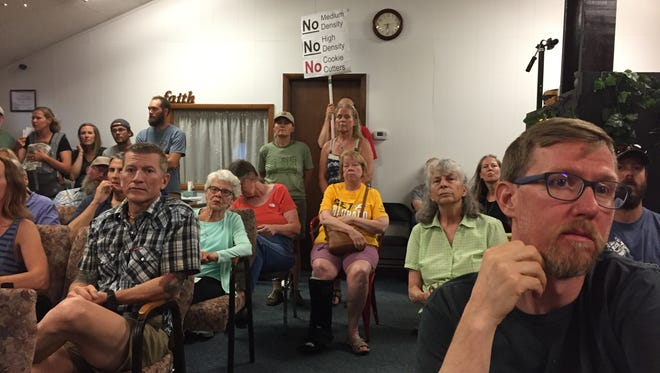 Neighbors protested a proposed 291-unit housing development on North Taft Hill Road.
