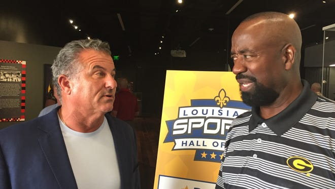 Former UL Monroe football player Tag Rome and former Grambling basketball player Larry Wright talk during Thursday's Louisiana Sports Hall of Fame event in Natchitoches.