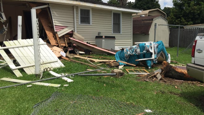 A stolen car driven by a juvenile crashed into a house on West Willow Street in Lafayette on Thursday.