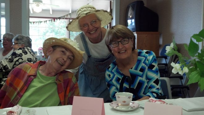 Judy Wittenkeller, left, Renny Lea and Jean Hanson at the June 21 tea to raise funds for Door CANcer.