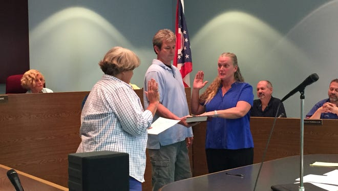 Vicki Wardlow, right, is sworn in as the new police chief for the Buckeye Lake Police Department by Mayor Peggy Wells. Wardlow has 29  years of law enforcement experience.
