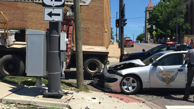 A state trooper's cruiser collided with a truck on Tuesday at Second and Diamond streets.