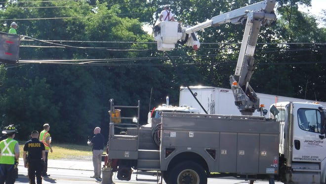An 18-wheeler attempting a u-turn through an empty parking lot on Main Street hit wires, causing the closure of part of Main Streetin Spotswood for more than a half-hour on Wednesday morning.