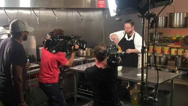 A camera crew from The Travel Channel's 'Food Paradise' show films Cantoro's Executive Chef Anthony Calabrese.