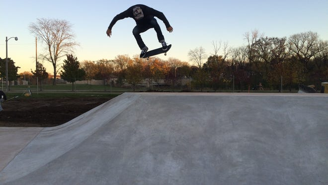A Tosa Skatepark user lifts off on a skateboard. The park opened in 2015 after a long journey. A skateboard park is being explored for the area around 27th Street, either on the Milwaukee side or the Greenfield side.