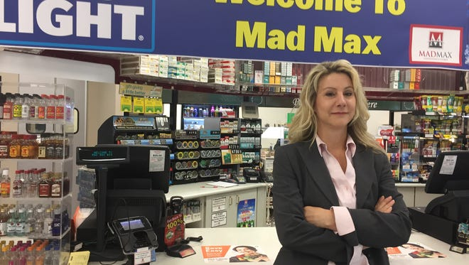 Janiece Maxwell, who recently sold the Mad Max chain of convenience stores, stands inside one of the stores in Port Washington.