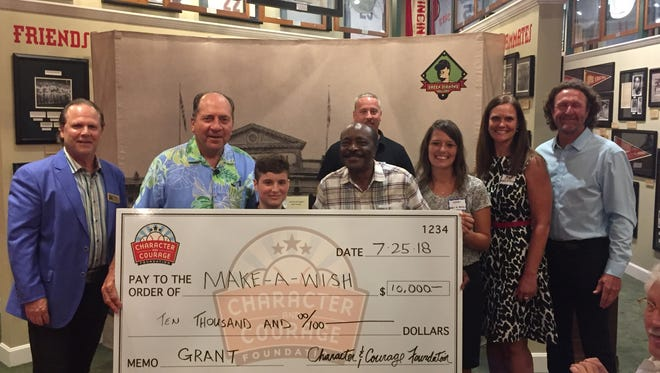 Make-A-Wish accepts a $10,000 grant from Character and Courage Foundation as well as Hall of Famers Johnny Bench, Joe Morgan and Robin Yount.