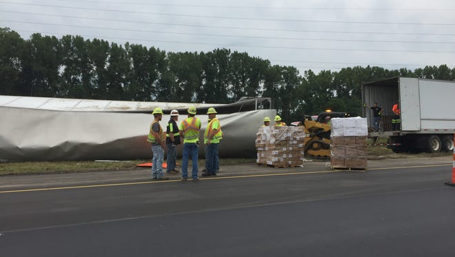 An overturned semi truck blocks one southbound lane of traffic on Interstate 71 on Sunday, July 29, 2018. The incident is about a mile and a half north of the U.S. 250 exit in Ashland.